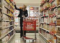 Jennifer English, of Columbus, shops in the grocery section of a Target store Tuesday, Nov. 14, 2006 in Columbus, Ohio.<br />