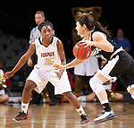SIOUX FALLS, SD - MARCH 6:  Bobbi Beckwith #24 of Omaha dribbles past Martha Burse #15 of IUPUI in the 2016 Summit League Tournament. (Photo by Dick Carlson/Inertia)