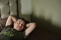 Samuel Oliver-Bruno relaxes on a hotel bed in Mexico days after his deportation. (Photo By Justin Cook) Samuel Oliver-Bruno in Mexico after being deported from Durham, NC, where he lived in sanctuary at City Well Church.