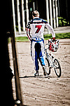 Connor Fields walking his BMX bike from the track after a gruelling practice, on the London Replica BMX track at the US Olympic Training Center in Chula Vista, CA