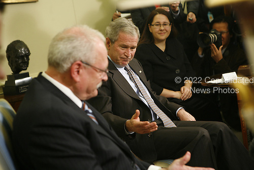 United States President George W. Bush addresses the press after a meeting with the  President of the Slovak Republic, Ivan Gasparovic in the Oval Office of the White House, in Washington DC, on October 09, 2008.<br /> Credit: Aude Guerrucci / Pool via CNP