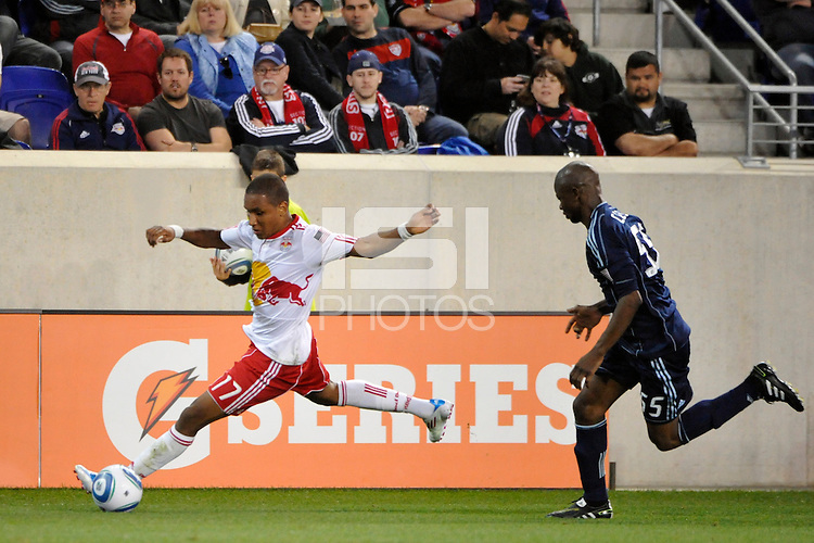 Juan Agudelo (17) of the New York Red Bulls is chased by Julio Cesar (55) of Sporting Kansas City. The New York Red Bulls defeated Sporting Kansas City 1-0 during a Major League Soccer (MLS) match at Red Bull Arena in Harrison, NJ, on April 30, 2011.