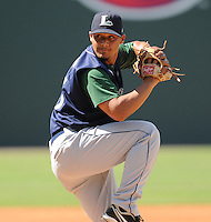 Starting pitcher Luis Cruz (15) of the Lexington Legends, a Houston Astros affiliate, in a game against the Greenville Drive on July 22, 2012, at Fluor Field at the West End in Greenville, South Carolina. Lexington won, 13-7. (Tom Priddy/Four Seam Images)