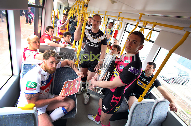 PICTURE BY VAUGHN RIDLEY/SWPIX.COM - Rugby League - Super League - Magic Weekend Preview - Deansgate Tram Stop, Manchester, England - 21/05/13 - Captains for the 14 Super League clubs gather inside a tram on the Deansgate Tram platform in Manchester on their way to the Etihad Stadium for the Magic Weekend.