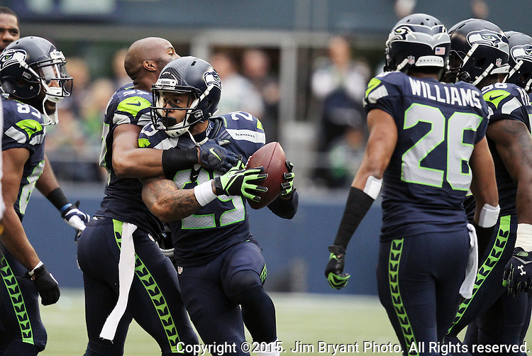 Seattle Seahawks free safety  Earl Thomas (26) celebates with teammates after he intercepted a pass from Carolina Panthers wide receiver Jerricho Cotchery (82)  at CenturyLink Field in Seattle on October 18, 2015. The Panthers came from behind with 32 seconds remaining in the 4th Quarter to beat the Seahawks 27-23.  ©2015 Jim Bryant Photography. All Rights Reserved.