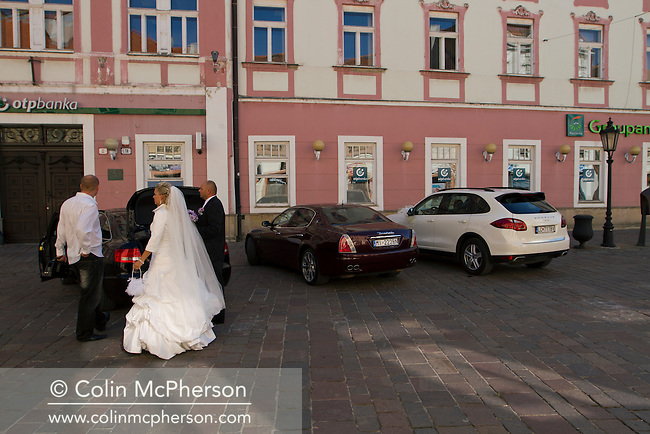 A bride-to-be prepares to make her way to St. Elizabeth Church in the city of Kosice, in the Slovak Republic before her marriage. The city, which lies in eastern Slovakia is the country's second largest after Bratislava and has been announced as European Capital of Culture in 2013, along with Marseille, France. Kosice was the seat of the Kosice Region, home to the Slovak Constitutional Court, three universities and many museums, galleries and theaters as well as an important industrial center.