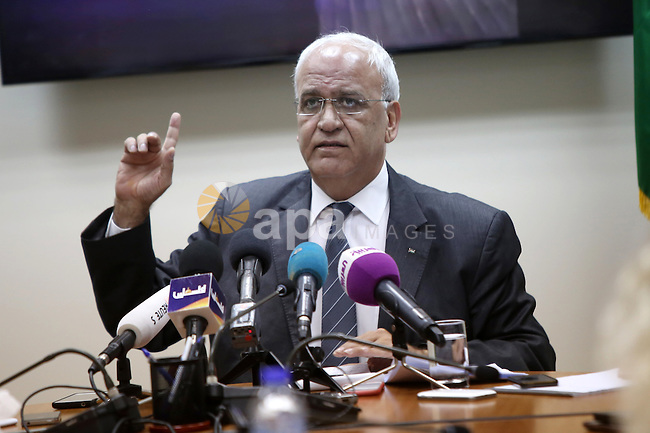 Palestinian chief negotiator Saeb Erekat speaks during a press conference in the West Bank city of Ramallah, on October 13, 2015. A wave of stabbings that hit Israel, Jerusalem and the West Bank this month along with violent protests in annexed east Jerusalem and the occupied West Bank, has led to warnings that a full-scale Palestinian uprising, or third intifada, could erupt. The unrest has also spread to the Gaza Strip, with clashes along the border in recent days leaving nine Palestinians dead from Israeli fire. Photo by Shadi Hatem