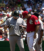 Washington, D.C. - June 17, 2006 -- New York Yankee first baseman Jason Giambi (25), left, shares a thought wirth his counterpart Nick Johnson (24) after being hit by a pitch in the third inning against the Washington Nationals at RFK Stadium in Washington, D.C. on June 17, 2006.  Nick Johnson is a former member of the Yankees.<br /> Credit: Ron Sachs / CNP