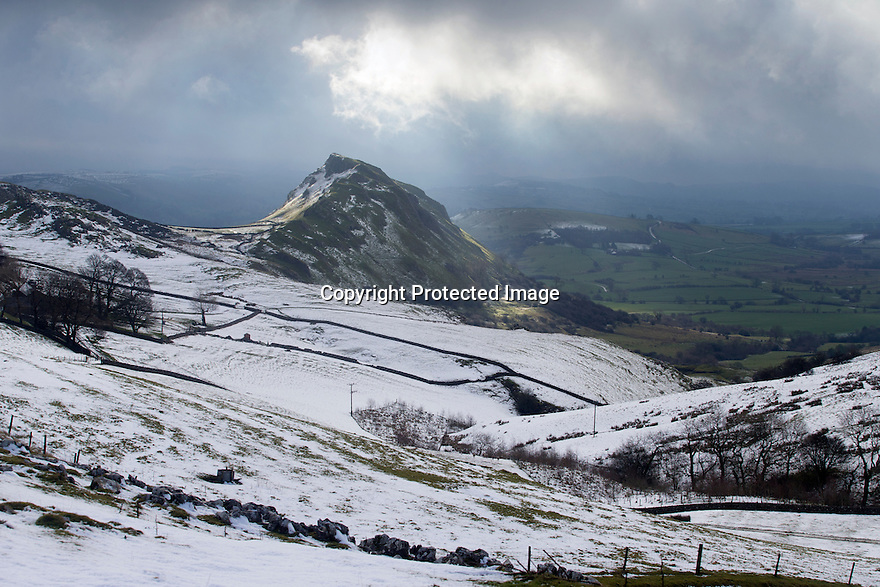 02/03/17<br /> <br /> Early morning light shining through dark clouds makes for a stunning view of Parkhouse Hill after overnight snowfall near Longnor in the Derbyshire Peak District.  <br /> <br /> All Rights Reserved F Stop Press Ltd. (0)1773 550665 www.fstoppress.com