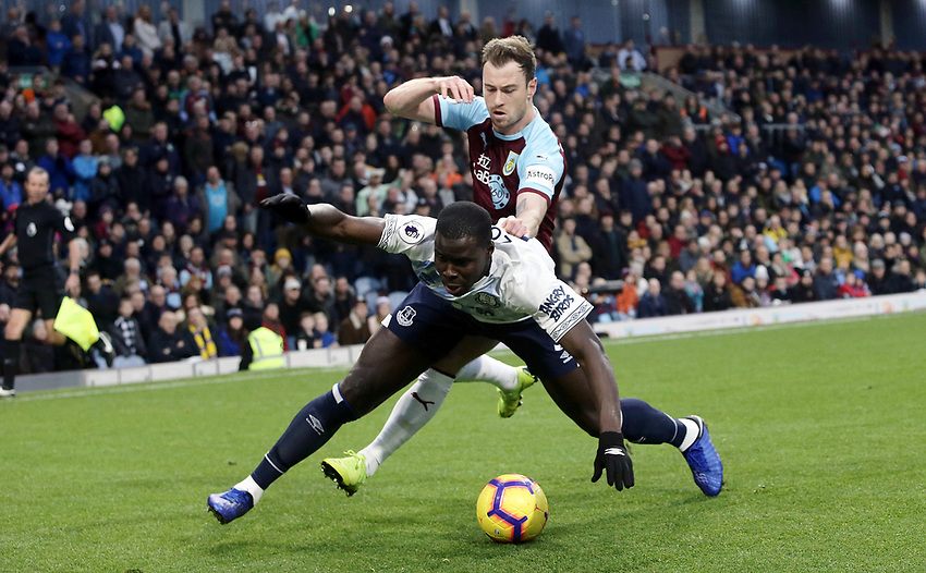 Everton's Kurt Zouma goes down under the challenge from Burnley's Ashley Barnes<br /> <br /> Photographer Rich Linley/CameraSport<br /> <br /> The Premier League - Burnley v Everton - Wednesday 26th December 2018 - Turf Moor - Burnley<br /> <br /> World Copyright © 2018 CameraSport. All rights reserved. 43 Linden Ave. Countesthorpe. Leicester. England. LE8 5PG - Tel: +44 (0) 116 277 4147 - admin@camerasport.com - www.camerasport.com