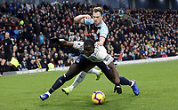 Everton's Kurt Zouma goes down under the challenge from Burnley's Ashley Barnes<br /> <br /> Photographer Rich Linley/CameraSport<br /> <br /> The Premier League - Burnley v Everton - Wednesday 26th December 2018 - Turf Moor - Burnley<br /> <br /> World Copyright &copy; 2018 CameraSport. All rights reserved. 43 Linden Ave. Countesthorpe. Leicester. England. LE8 5PG - Tel: +44 (0) 116 277 4147 - admin@camerasport.com - www.camerasport.com