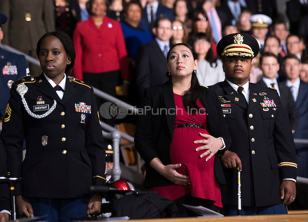 Audience members watch the Armed Forces Full Honor Review Farewell Ceremony for United States President Barack Obama at Joint Base Myers-Henderson Hall, in Virginia on January 4, 2017. The five braces of the military honored the president and vice-president for their service as they conclude their final term in office. <br /> Credit: Kevin Dietsch / Pool via CNP /MediaPunch