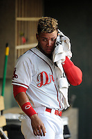 Second baseman Yoan Moncada of the Greenville Drive cools down in the dugout during a game against the Rome Braves on Monday, June 15, 2015, at Fluor Field at the West End in Greenville, South Carolina. The Cuban-born 19-year-old Red Sox signee has been ranked the No. 1 international prospect in baseball by Baseball America. (Tom Priddy/Four Seam Images)