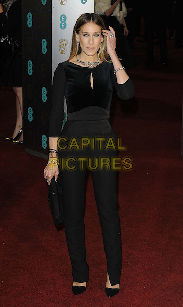 Sarah Jessica Parker.EE British Academy Film Awards at The Royal Opera House, London, England 10th February 2013.BAFTA BAFTAS arrivals full length black top trousers velvet jumpsuit sjp hand arm.CAP/CAN.©Can Nguyen/Capital Pictures.