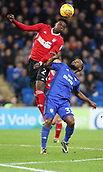 31st October 2017, Cardiff City Stadium, Cardiff, Wales; EFL Championship football, Cardiff City versus Ipswich Town; Dominic Iorfa of Ipswich Town gets up high over Junior Hoilett of Cardiff City to head the ball