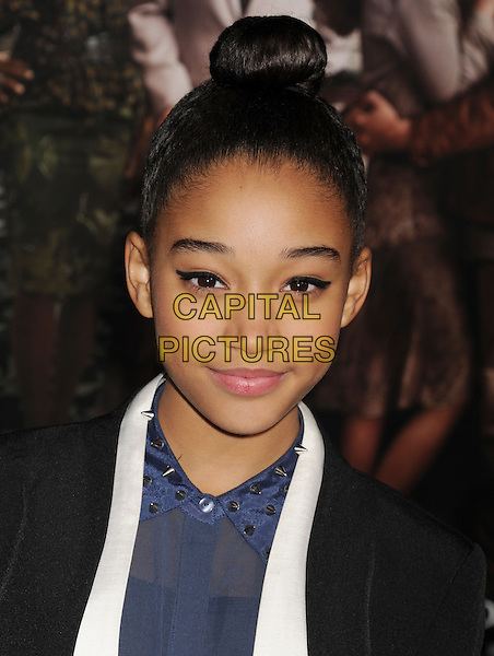 """Amandla Stenberg.arriving at the Los Angeles premiere of """"Beautiful Creatures"""" at TCL Chinese Theatre in Hollywood, California, USA, .February 6th, 2013..portrait headshot hair up bun blue shirt black white studded studs collar shirt .CAP/ROT/TM.©Tony Michaels/Roth Stock/Capital Pictures"""