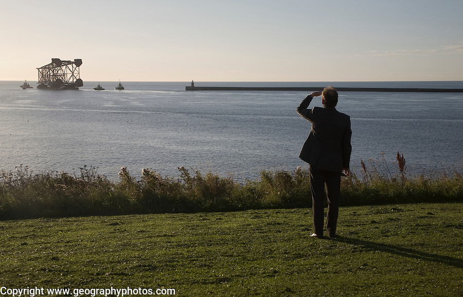Large North Sea oil drilling platform leaving the River Tyne, Tynemouth, Northumberland, England