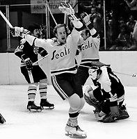Seals Stan Gilbertson scores goal against the Bobton Bruins goalie Ed Johnston. (1971 photo/Ron Riesterer)