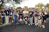 20 December 2011:  FIU fans pose with Roary on their way to tailgating prior to the game.  The Marshall University Thundering Herd defeated the FIU Golden Panthers, 20-10, to win the Beef 'O'Brady's St. Petersburg Bowl at Tropicana Field in St. Petersburg, Florida.