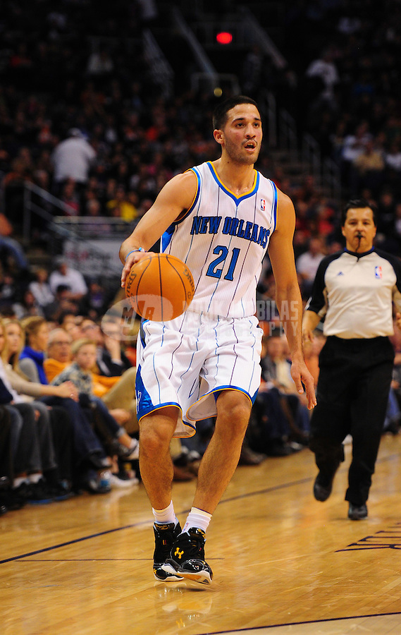 Dec. 26, 2011; Phoenix, AZ, USA; New Orleans Hornets guard Greivis Vasquez controls the ball during the game against the Phoenix Suns at the US Airways Center. The Hornets defeated the Suns 85-84. Mandatory Credit: Mark J. Rebilas-USA TODAY Sports