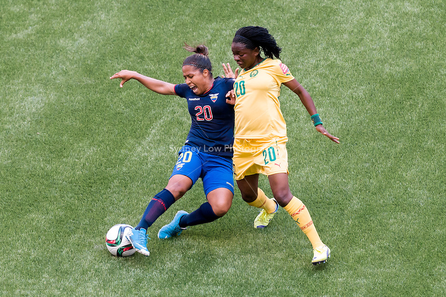 June 8, 2015: Genevieve NGO MBELECK of Cameroon and Denise PESANTES of Ecuador fights for the ball during a Group C match at the FIFA Women's World Cup Canada 2015 between Cameroon and Ecuador at BC Place Stadium on 8 June 2015 in Vancouver, Canada. Sydney Low/AsteriskImages