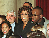 Whitney Houston and her husband, Bobby Brown stand with United States Senator Chris Dodd (Democrat of Connecticut) as they join members of the World Children's Choir following her press confrence in the Senate Caucus Room on Capitol Hill in Washington, D.C. on October 1, 1997.  Ms. Houston was announcing an HBO special to be aired Sunday, October 5, 1997, live from DAR Constitution Hall in Washington to benefit the Children's Defense Fund..Credit: Ron Sachs / CNP