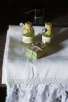 Bath oil and soap made from local olive oil on a white linen hand towel in the bathroom