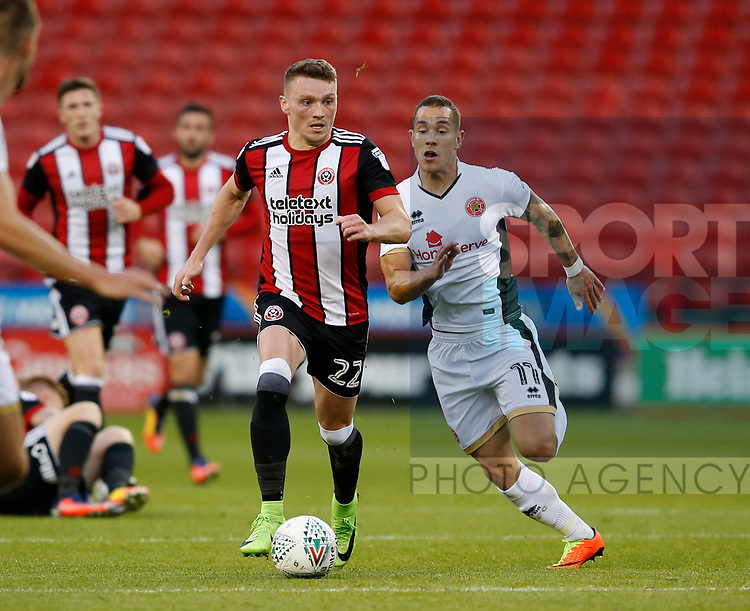 Caolan Lavery of Sheffield Utd tussles with Kieron Morris of Walsalll during the Carabao Cup First Round match at Bramall Lane Stadium, Sheffield. Picture date: August 9th 2017. Pic credit should read: Simon Bellis/Sportimage