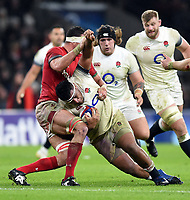 Mako Vunipola of England is tackled by Aaron Shingler of Wales. Natwest 6 Nations match between England and Wales on February 10, 2018 at Twickenham Stadium in London, England. Photo by: Patrick Khachfe / Onside Images