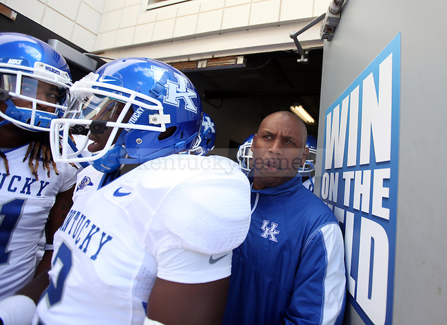 in the first half of the UK vs Ubof L football game, kicking off Joker Phillip's reign as head coach on Saturday, September 5, 2010. Photo by Britney McIntosh | StaffUK football head coach Joker Phillips walks out of the locker room and onto the field before the first half of the UK vs Uof L football game, kicking off Joker Phillip's reign as head coach on Saturday, September 5, 2010. Photo by Britney McIntosh | Staff