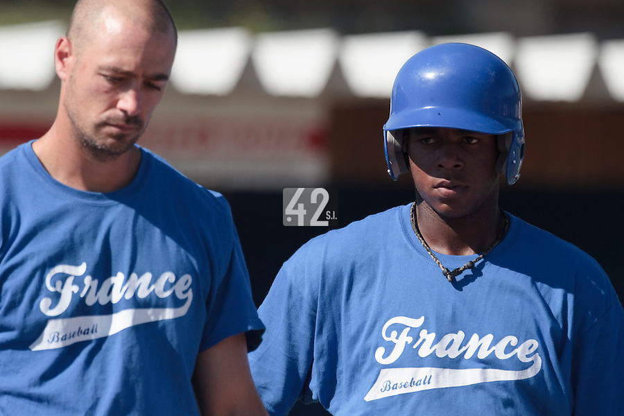 20 july 2010: Omar Williams of Team France, next to Jerome Rousseau, listens to John Haar during a practice prior to the 2010 European Championship Seniors, in Neuenburg, Germany.