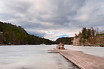 MARCH 13, 2011 - NEW PALTZ: Frozen Lake Mohonk with pier, glimpse of national landmark Mohonk Mountain House on one side and in far distance on mountain, the Mohonk Tower, cloudy winter morning sky, in New Paltz, New York. Editorial Use Only