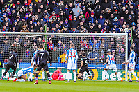 Crystal Palace's defender James Tomkins (5) prods it in to make it 1-0 during the EPL - Premier League match between Huddersfield Town and Crystal Palace at the John Smith's Stadium, Huddersfield, England on 17 March 2018. Photo by Stephen Buckley / PRiME Media Images.