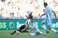 Calcio, Serie A: Lazio vs Juventus. Roma, stadio Olimpico, 27 agosto 2016.<br /> Juventus&rsquo; Paulo Dybala, left, is tackled by Lazio&rsquo;s Stefan Radu, center, during the Serie A soccer match between Lazio and Juventus, at Rome's Olympic stadium, 27 August 2016. Juventus won 1-0.<br /> UPDATE IMAGES PRESS/Isabella Bonotto