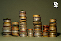 Stacks of various currency coins on green background (Licence this image exclusively with Getty: http://www.gettyimages.com/detail/sb10065145q-001 )