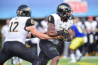 Newark, DE - OCT 29, 2016: Triston Harris (12) hands the balls off to Towson Tigers running back Deshaun Wethington (4) during game between Towson and Delaware at Delaware Stadium Tubby Raymond Field in Newark, DE. (Photo by Phil Peters/Media Images International)