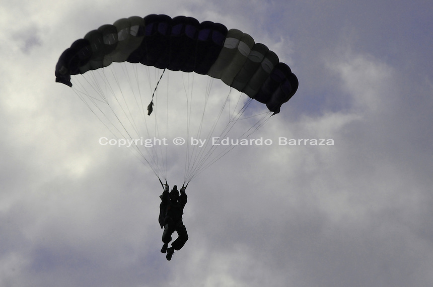 "Scottsdale, Arizona - A skydiver is seen in this photograph taking part in a swooping competition on April 9, 2011. He was part of a team of aerial performers who jumped from a helicopter and tried landing at a marked point on the ground. These ""canopy pilots"" leveled off and navigated a course in front of spectators. The event was a ""swooping,"" which consists of competitive parachuting where skydivers -also known as ""canopy pilots""- try to touch down at a ground mark to win. Photo by Eduardo Barraza © 2011"