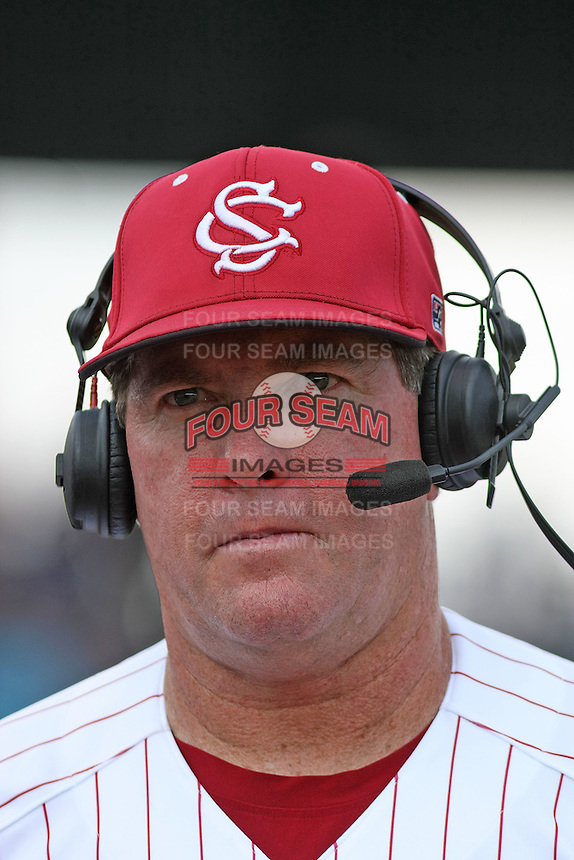 University of South Carolina Gamecocks Head Coach Ray Tanner wearing a headset and being interviewed between innings by the ESPN announcers during the 2nd and deciding game of the NCAA Super Regional vs. the University of Coastal Carolina Chanticleers on June 13, 2010 at BB&T Coastal Field in Myrtle Beach, SC.  The Gamecocks defeated Coastal Carolina 10-9 to advance to the 2010 NCAA College World Series in Omaha, Nebraska. Photo By Robert Gurganus/Four Seam Images