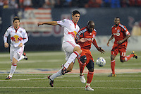 Andrew Boyens (27) of the New York Red Bulls and Ali Gerba (10) of Toronto FC battle for the ball. The New York Red Bulls defeated Toronto FC 5-0 during a Major League Soccer match at Giants Stadium in East Rutherford, NJ, on October 24, 2009.