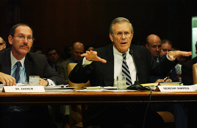 9/24/03.IRAQ SUPPLEMENTAL APPROPRIATIONS--Pentagon Comptroller Dov S. Zakheim and Defense Secretary Donald H. Rumsfeld, during the Senate Appropriations hearing on the President's fiscal year 2004 supplemental request for Iraq and Afghanistan. .CONGRESIONAL QUARTERLY PHOTO BY SCOTT J. FERRELL