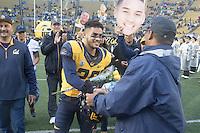 BERKELEY, CA - November 26, 2016: Bug Rivera (26) shakes hands with Cal Athletic Director Mike Williams on Senior Day. Cal played UCLA at California Memorial Stadium.