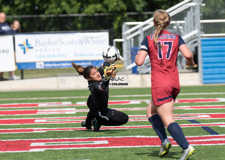 Tompkins Falcons goalkeeper Cailey Croson (1) makes a stop during the Class 6A UIL girls soccer state final between the Pflugerville Hendrickson Hawks and the Katy Tompkins Falcons at Birkelbach Field in Georgetown, Texas, on April 15, 2017. Hendrickson won 2-0.