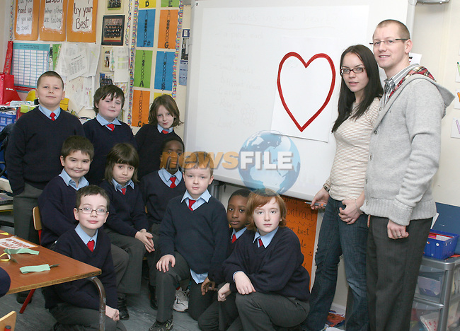 Grace Clarke from Droichead Arts Centre with children from St Patricks NS and teacher Alan Weston in the lead up to Valentines Day...Photo NEWSFILE/Jenny Matthews.(Photo credit should read Jenny Matthews/NEWSFILE)....This Picture has been sent you under the condtions enclosed by:.Newsfile Ltd..The Studio,.Millmount Abbey,.Drogheda,.Co Meath..Ireland..Tel: +353(0)41-9871240.Fax: +353(0)41-9871260.GSM: +353(0)86-2500958.email: pictures@newsfile.ie.www.newsfile.ie.FTP: 193.120.102.198.