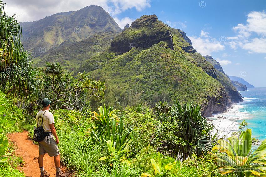 A state park ranger pauses while hiking the Kalalau Trail near Hanakapi'ai Beach, North Kaua'i.