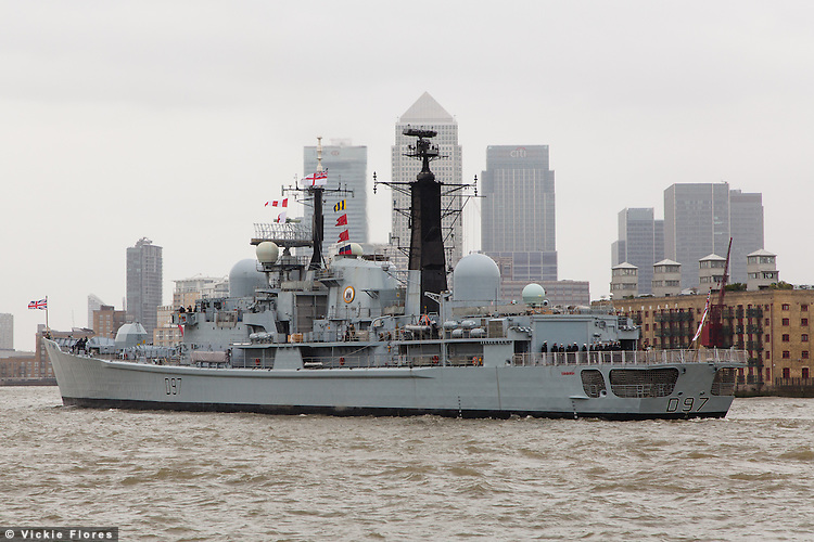 HMS Edinburgh leaves London for the last time on 12 May 2013 and passes Canary Wharf on the River Thames for the start of her farewell tour of Great Britain. HMS Edinburgh is a Type 42 (Batch 3) destroyer of the Royal Navy was decommissioned on 6 June 2013.