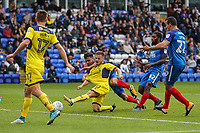 Jack Payne of Oxford United gets a shot away whilst his shirt is being pulled during the Sky Bet League 1 match between Peterborough and Oxford United at the ABAX Stadium, London Road, Peterborough, England on 30 September 2017. Photo by David Horn.
