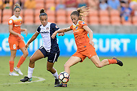Houston, TX - Saturday July 15, 2017: Janine Beckie takes a shot at Washington's goal in front of Mallory Pugh during a regular season National Women's Soccer League (NWSL) match between the Houston Dash and the Washington Spirit at BBVA Compass Stadium.