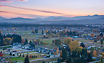 Idaho, North, Kootenai County, Coeur d'Alene. An evening view of Dalton Gardens and Coeur d'Alene as viewed from Canfield Mountain in autumn.