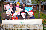 Getting ready for the Scoil Mhic Easmainn annual Christmas Fair this Sunday, from front l-r were: Ella Nic Ghabhann, Tara Nic Ghabhann, Elsie Peig Nic Ruairí and Sophie Lowham, Back l-r were: Annmarie Rogers, Kathryn Smith and Annette Lowham.