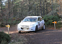 Euan Thorburn - Paul Beaton in their Ford Focus WRC competing at Junction 6 on the Munro Scotch Beef Millbuie Special Stage 1 on the 2014 Arnold Clark/Thistle Hotel Snowman Rally, supported by Highland Office Equipment, part of Capital Document Solutions which was organised by Highland Car Club and based in Inverness on 22.2.14; Round 1 of the 2014 RAC MSA Scottish Rally Championship sponsored by ARR Craib Transport Limited.